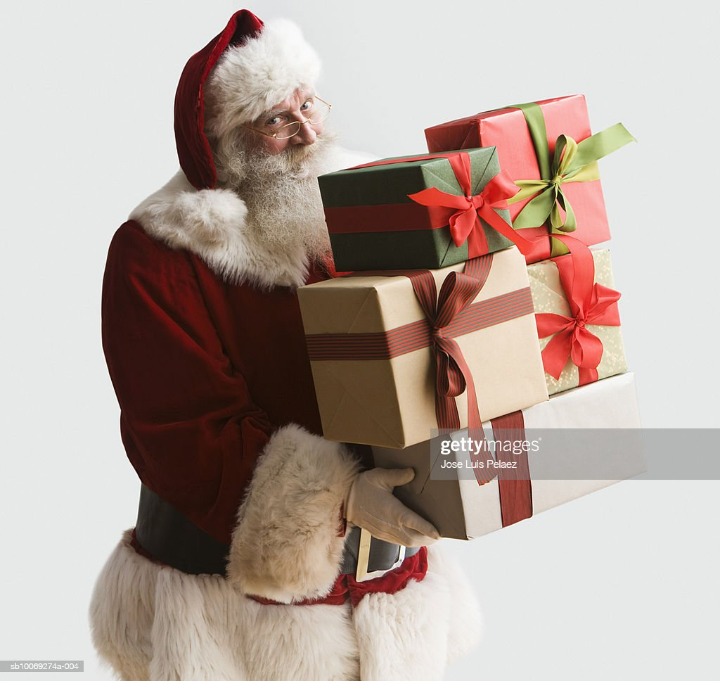 Santa Clause carrying presents, portrait, close-up : Stockfoto