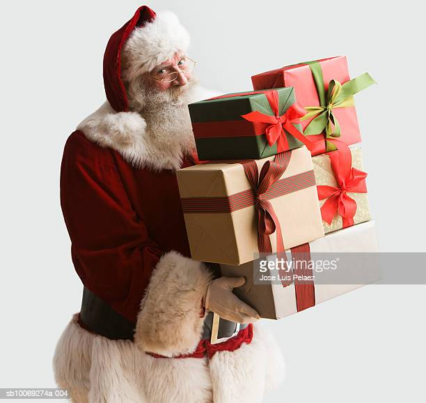 Santa Clause carrying presents, portrait, close-up