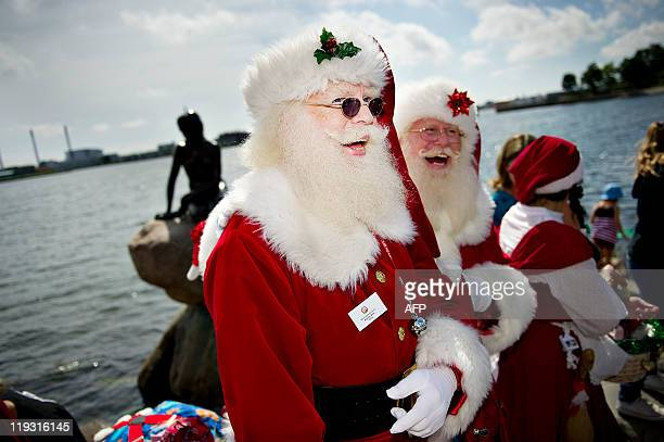 Santa Claus'es from all over the world gather at Hans Christian Andersen's fairy tale sculpture 'The Little Mermaid' in Copenhagen on July 18 2011...