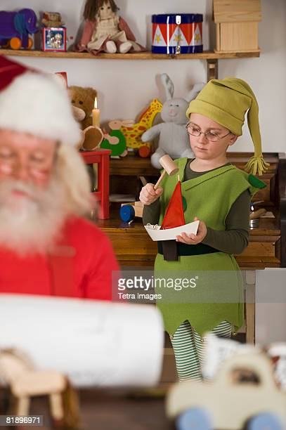 Santa Claus?s elf making toy