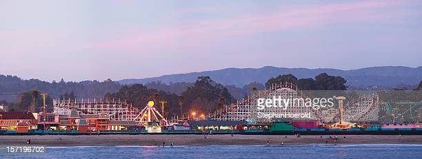 santa cruz boardwalk: roller coaster after sunset - boardwalk stock pictures, royalty-free photos & images