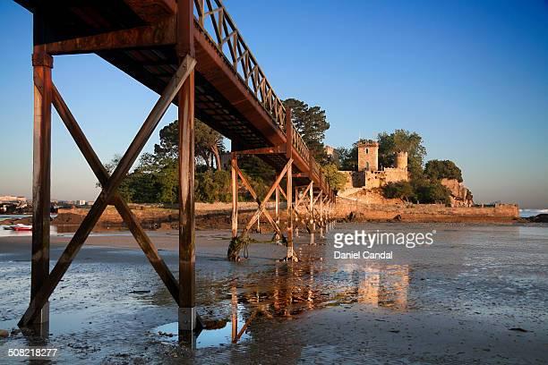 Santa Cruz Castle in A Coruna in a summer sunrise with low tide