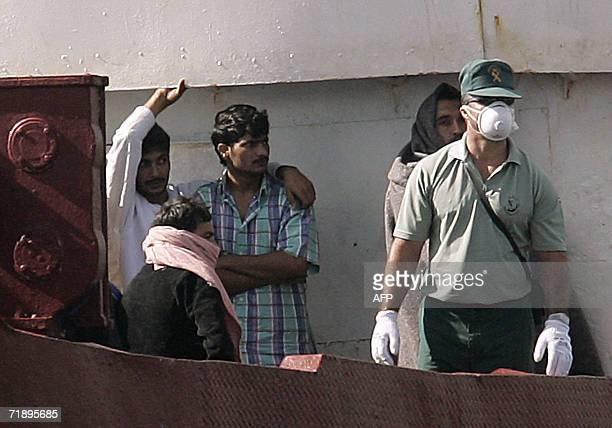 A boat carrying over 200 illegal Pakistani and Sri Lankan immigrants is escorted into the port of Santa Cruz de Tenerife on the Spanish Canary island...