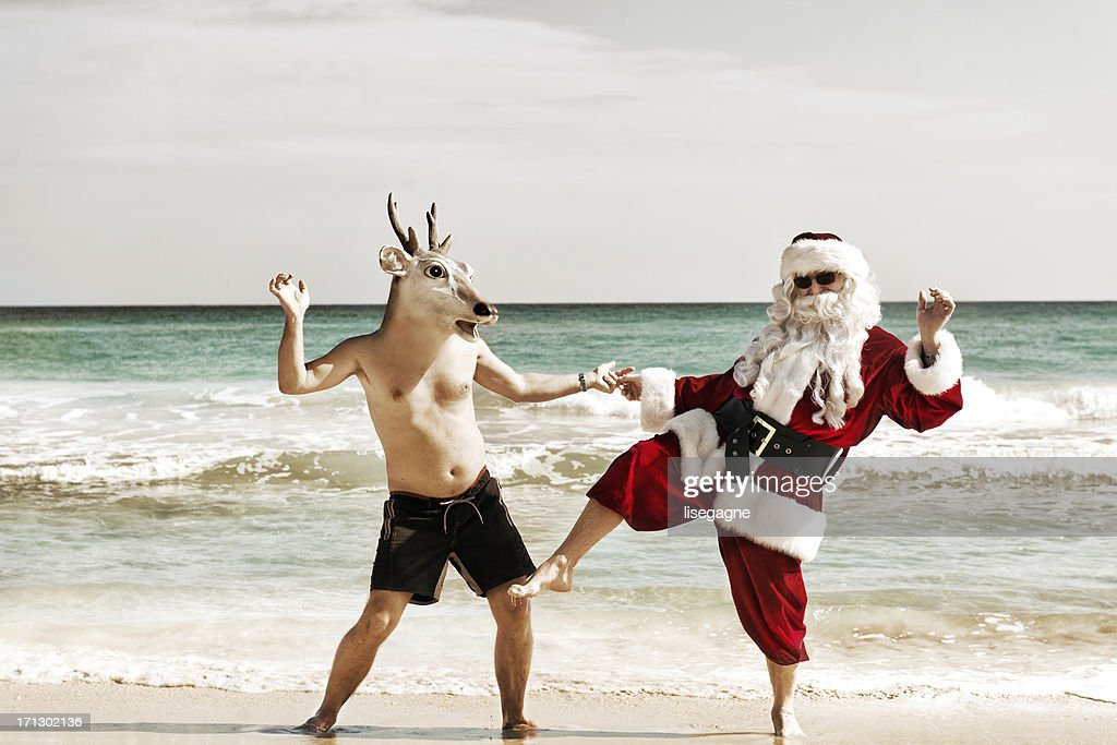 Santa dancing with his friend : Stock Photo