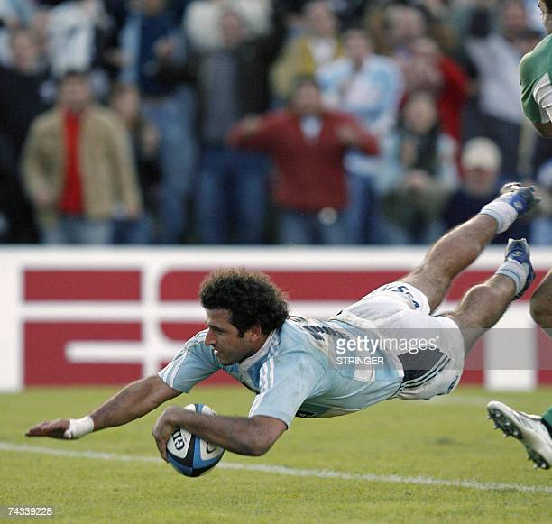 Argentina's centre Miguel Avramovic of Los Pumas scores a try against Ireland during their first of two Rugby Union test matches at Colon de Santa Fe...