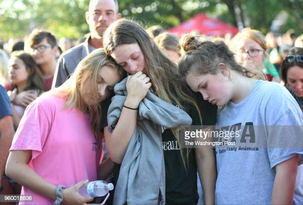 Santa Fe High school students Alexis Markis Kassidy Taves and Averi Gary hold each other during a vigil for the victims of the Santa Fe High School...