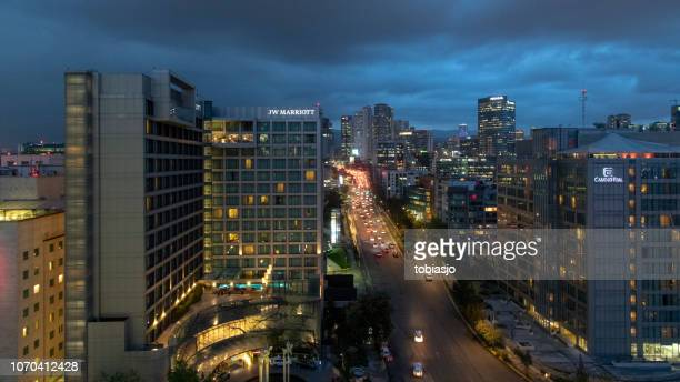 santa fe in mexico city by night - santa fe province stock photos and pictures