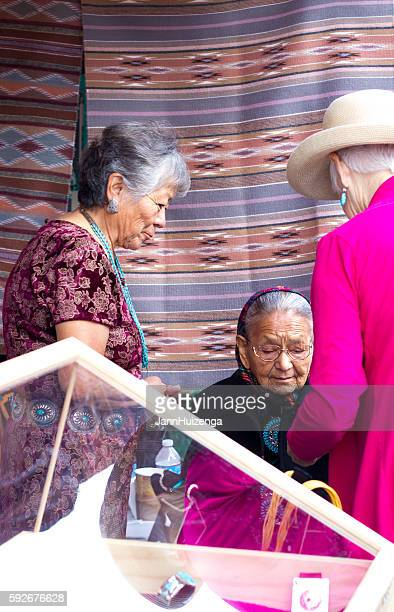 2016 Santa Fe Indian Market: Navajo Weavers with Rugs