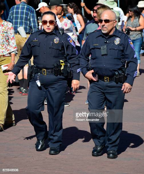 Santa Fe New Mexico police officers walk through the historic Plaza in Santa Fe New Mexico during a festival in the capital city
