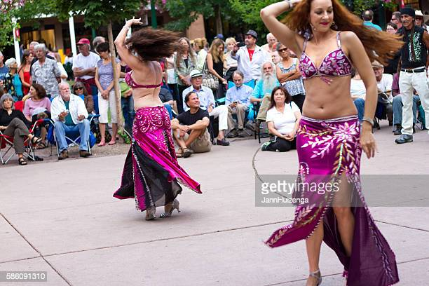 santa fe, nm: bellydancers on the historic downtown plaza - belly dancing stock photos and pictures