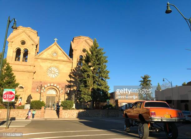 santa fe, nm: lowrider car, saint francis cathedral - low rider stock pictures, royalty-free photos & images