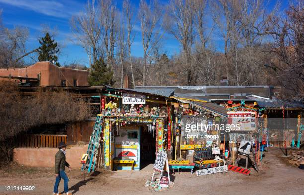santa fe, nm: man walking past art gallery on canyon road - santa fe new mexico stock pictures, royalty-free photos & images