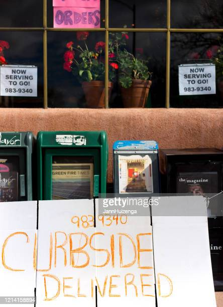 santa fe, nm: sign on restaurant window: curbside delivered! - curb stock pictures, royalty-free photos & images