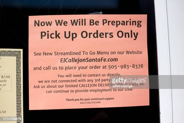 santa fe, nm: sign on restaurant window: pick up orders only - curbside pickup stock pictures, royalty-free photos & images