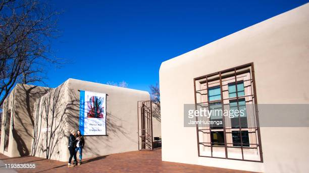 santa fe, nm: young women outside georgia o'keeffe museum - georgia okeeffe stock pictures, royalty-free photos & images