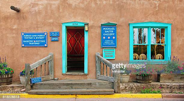 santa fe old adobe house with stucco wall and flowers - pueblo built structure stock photos and pictures