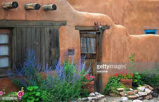 Santa Fe Old Adobe House with Stucco Wall and Flowers