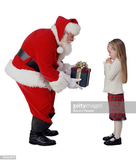 Santa giving gift to girl