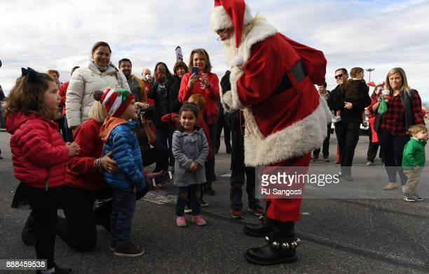Santa greets volunteers and families before the start of the Denver Santa Claus Shop on December 8 2017 in Denver Colorado Parents get a 100point...