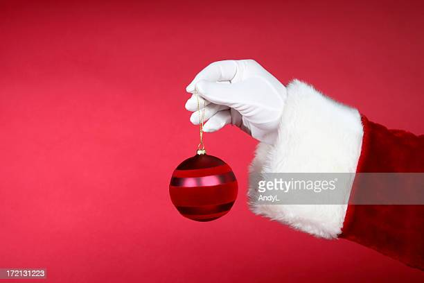 Santa Hands: Holding Red Ornament