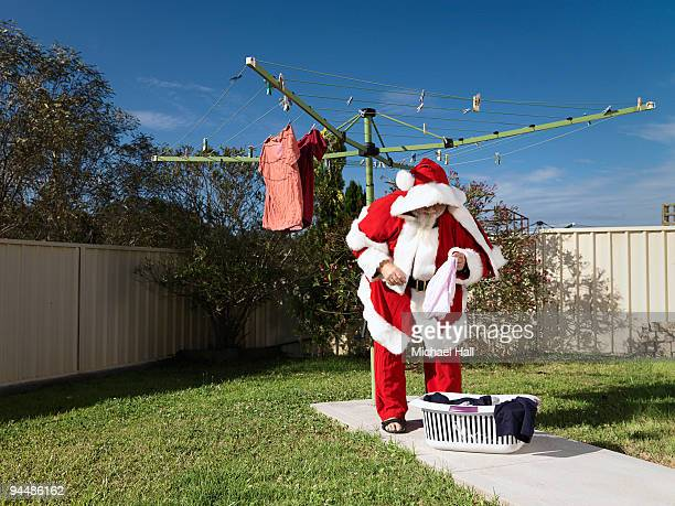 santa hanging out the washing - chores stock pictures, royalty-free photos & images
