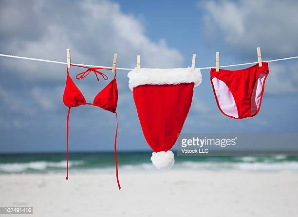 Santa hat and bikini on a clothesline