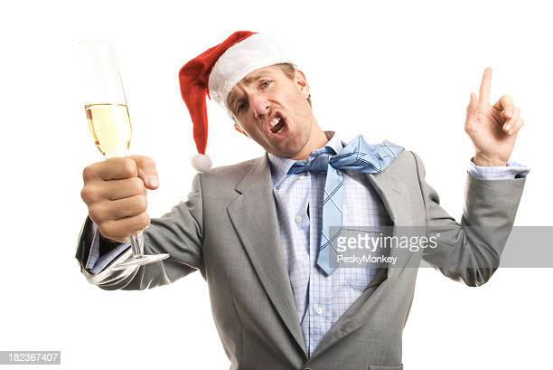 Santa Hat Businessman Toasts the Camera at Christmas Office Party