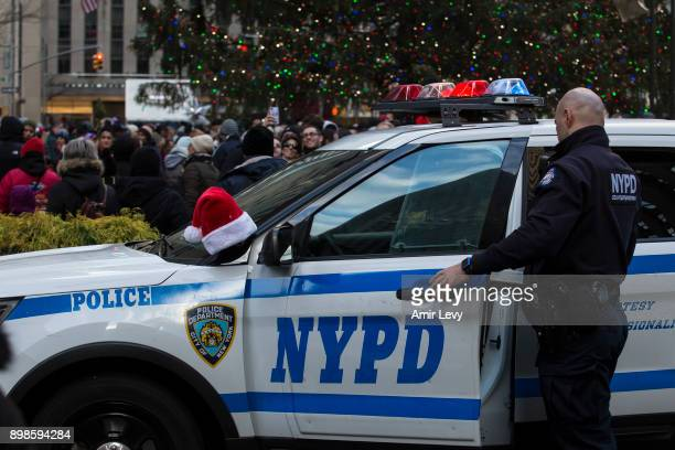 Santa hat hang on an NYPD vehicle at Rockefeller Center on Christmas day on December 25 2017 in New York City Security in New York is on alert as...