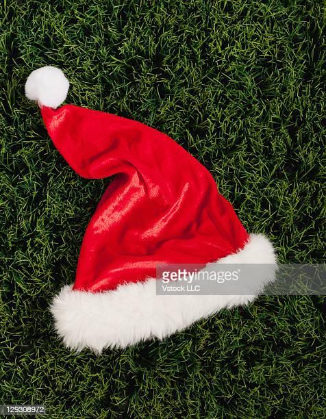Santa hat lying on artificial garss