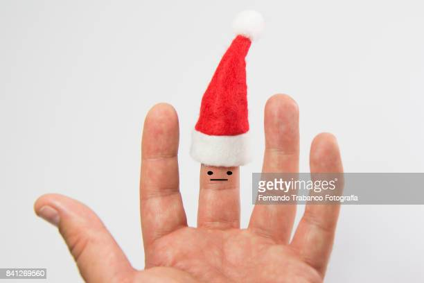 santa hat on a finger - santa face stock pictures, royalty-free photos & images
