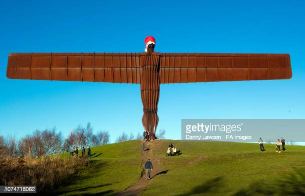 Santa hat on the 20 metres tall steel sculpture 'Angel of the North', outside Gateshead, Tyne and Wear, in NE Engand.