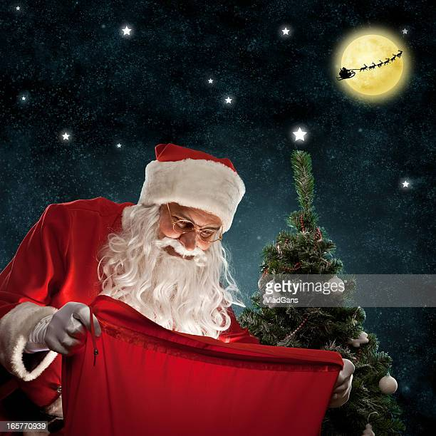 Santa holding a bag of gifts