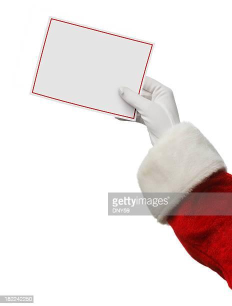 Santa sosteniendo una tarjeta en blanco