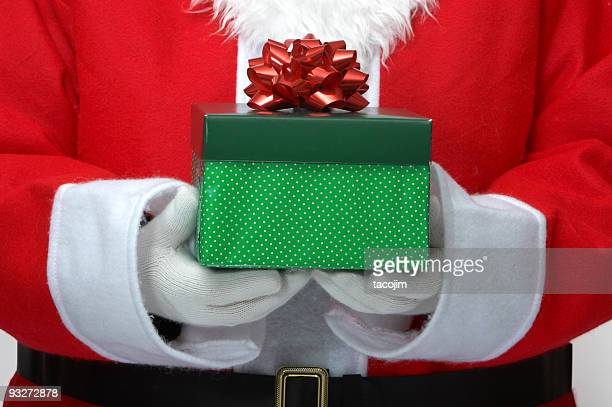 Santa holding a green box present with a red bow on
