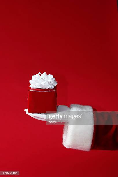 Santa Holding Red and White Christmas Gift