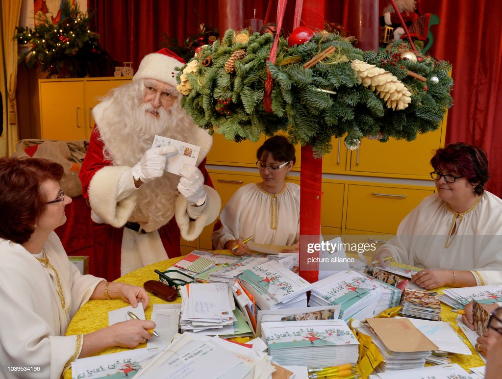 santa holds letters during the opening of the christmas post office in himmelpfort germany - Christmas Eve Post Office Hours