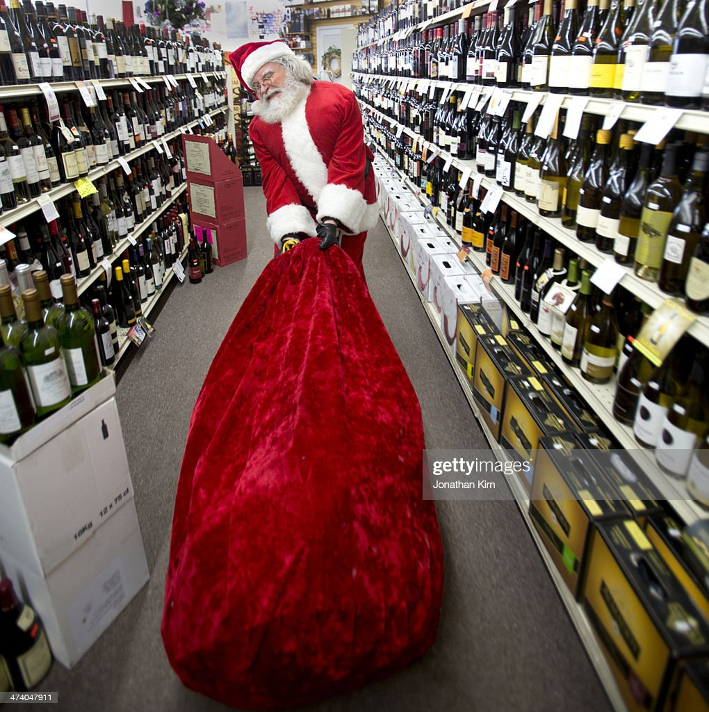 Santa in a liquor store : Stock Photo