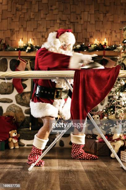 Santa ironing his pants