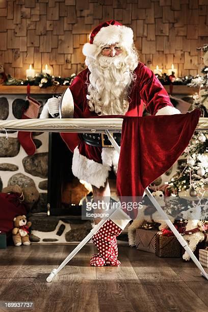 Santa ironing his pants