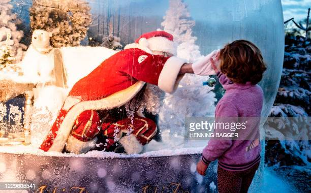 Santa is seen in a coronavirus-safe plastic bubble at the Zoo in Aalborg on November 13, 2020. / Denmark OUT
