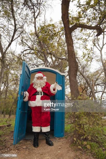 santa leaving portable toilet - portable toilet stock photos and pictures