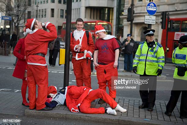 A Santa lies protrate on the pavement near Trafalagar Square waiting for an ambulance He had collapsed with the most likely cause being alchohol...