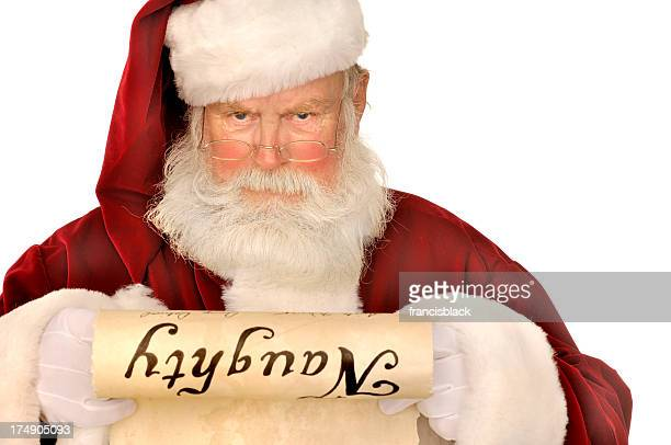 santa looking at naughty list - naughty santa stock photos and pictures