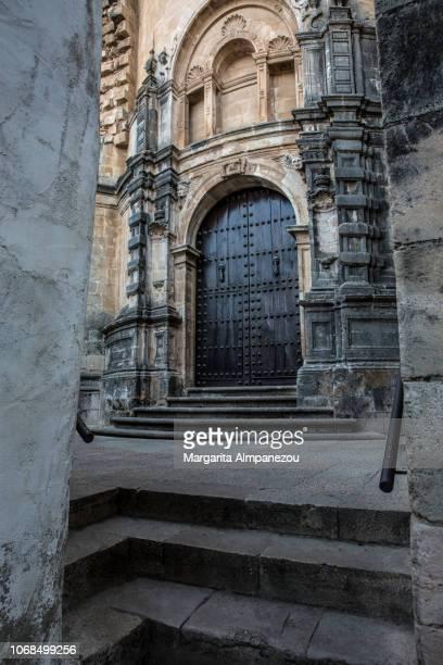 Santa María la Mayor church framed by stone walls