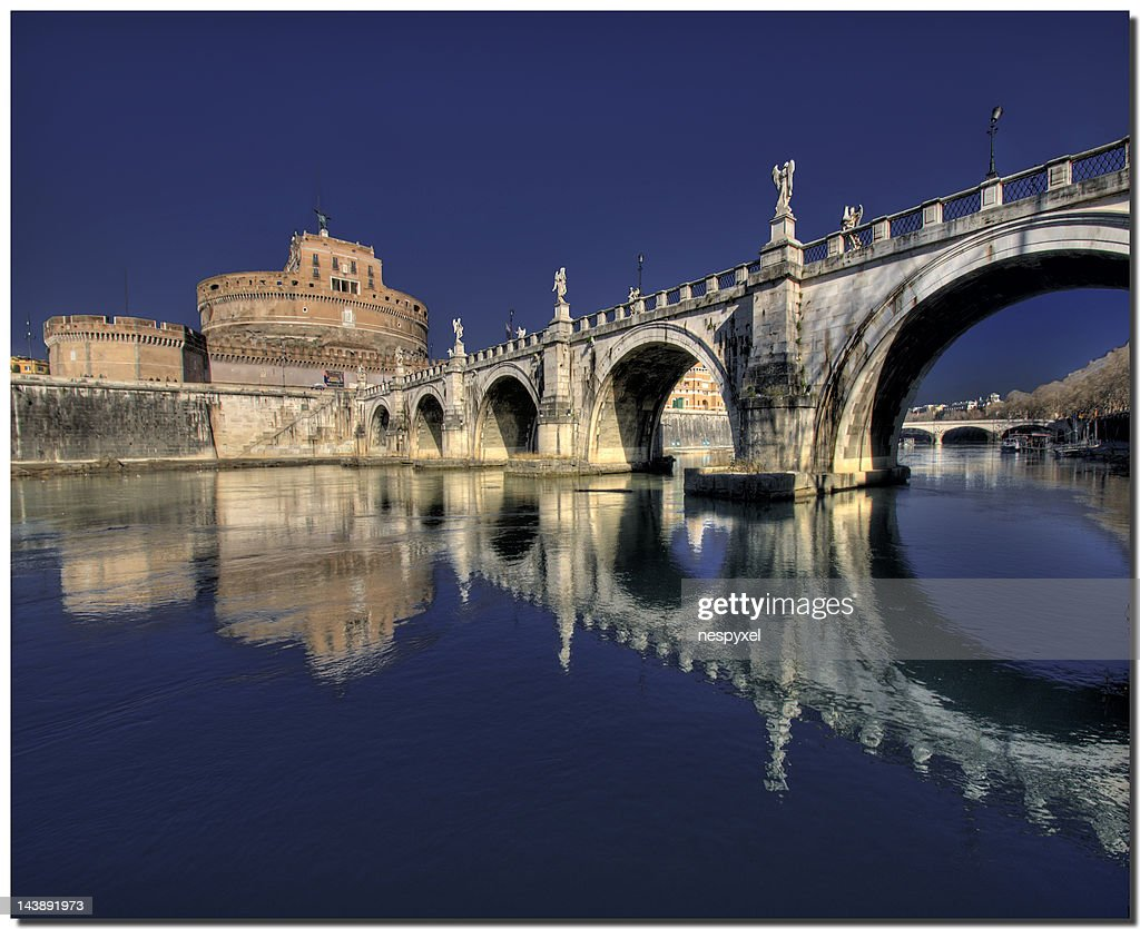 Santa Maria and arch bridge : Stock Photo