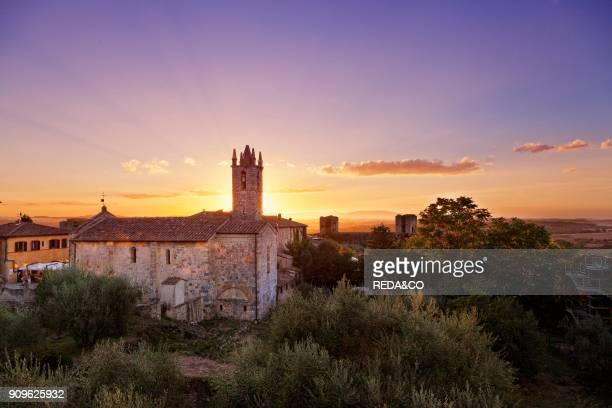 Santa Maria Assunta chuch at sunset Monteriggioni Tuscany Italy Europe