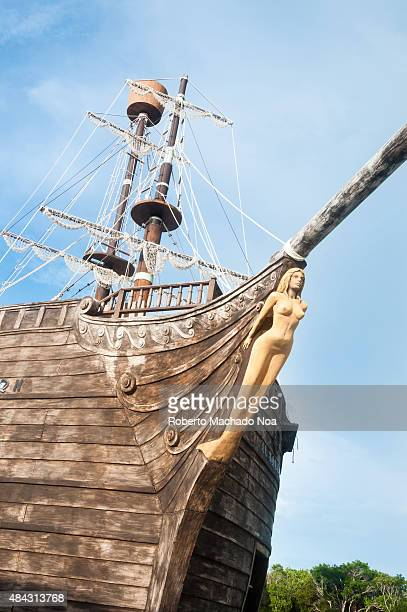 Santa Maria Key detail a bar inside a pirate shipLow angle frontal view of a boat with sail mast and figurehead of a mermaid tied in front