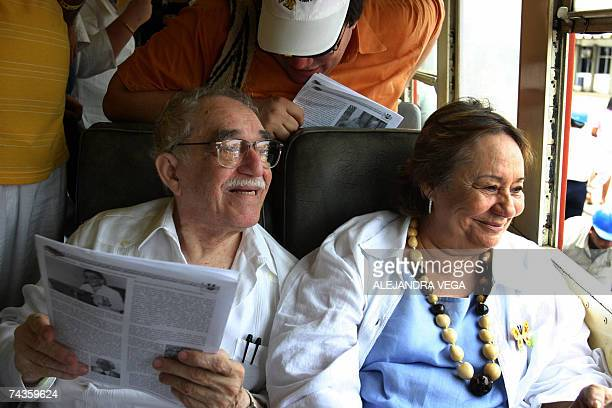 Colombian Nobel Prize for Literature 1982 Gabriel Garcia Marquez sitting in the carriage alongisde his wife Mercedes Barcha smiles upon arriving at...