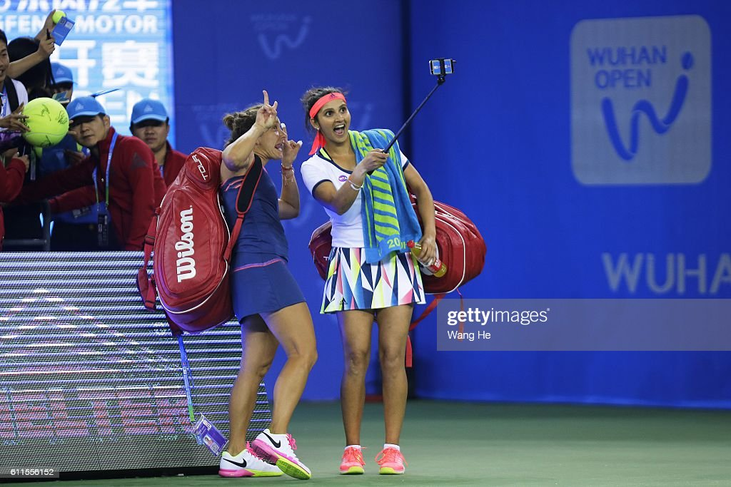 Santa Mirza of India and Barbora Strycova of Czech use iPhoto take picture with fans after won the match against TaipeiÔs Hao Ching Chan and Yung Jan Chan during the semi-final match on day 6 at Optics Valley International Tennis Center on September 30, 2016 in Wuhan, China.