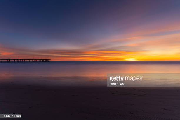 santa monica beach at sunset - los angeles mountains stock pictures, royalty-free photos & images